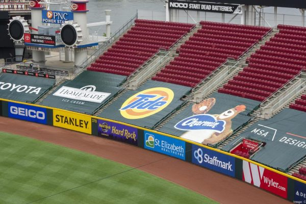 Sports venues have converted seats into large advertising placements to salvage sponsorship revenue